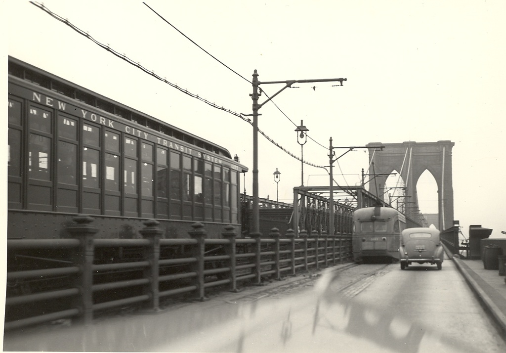 (163k, 1024x714)<br><b>Country:</b> United States<br><b>City:</b> New York<br><b>System:</b> New York City Transit<br><b>Line:</b> BMT Fulton<br><b>Location:</b> Brooklyn Bridge <br><b>Car:</b> BMT Elevated Gate Car 1377 <br><b>Photo by:</b> Ed Watson/Arthur Lonto Collection<br><b>Collection of:</b> Frank Pfuhler<br><b>Date:</b> 1942<br><b>Viewed (this week/total):</b> 1 / 1538