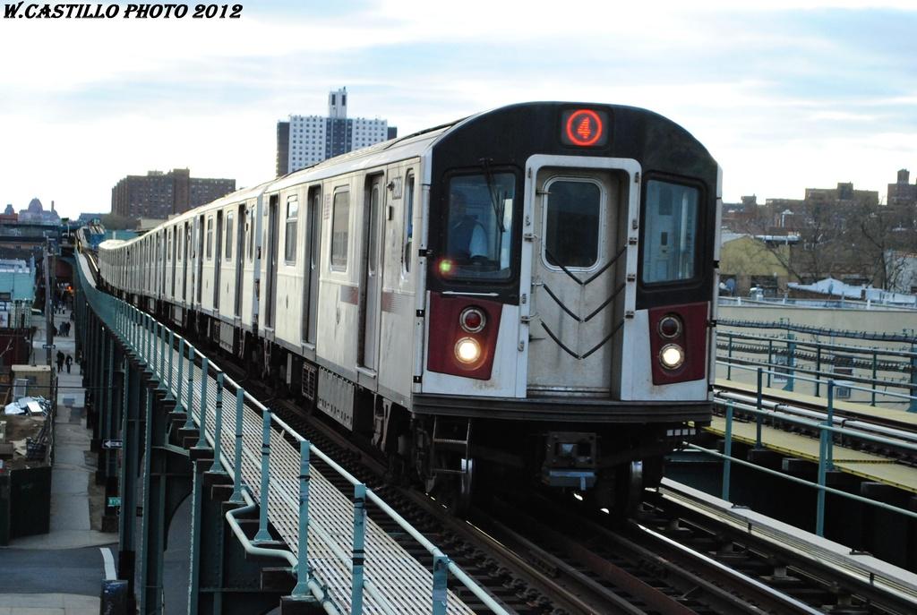 (285k, 1024x687)<br><b>Country:</b> United States<br><b>City:</b> New York<br><b>System:</b> New York City Transit<br><b>Line:</b> IRT Brooklyn Line<br><b>Location:</b> Van Siclen Avenue <br><b>Route:</b> 4<br><b>Car:</b> R-142A (Supplemental Order, Kawasaki, 2003-2004)  7801 <br><b>Photo by:</b> Wilfredo Castillo<br><b>Date:</b> 3/29/2012<br><b>Viewed (this week/total):</b> 0 / 1248