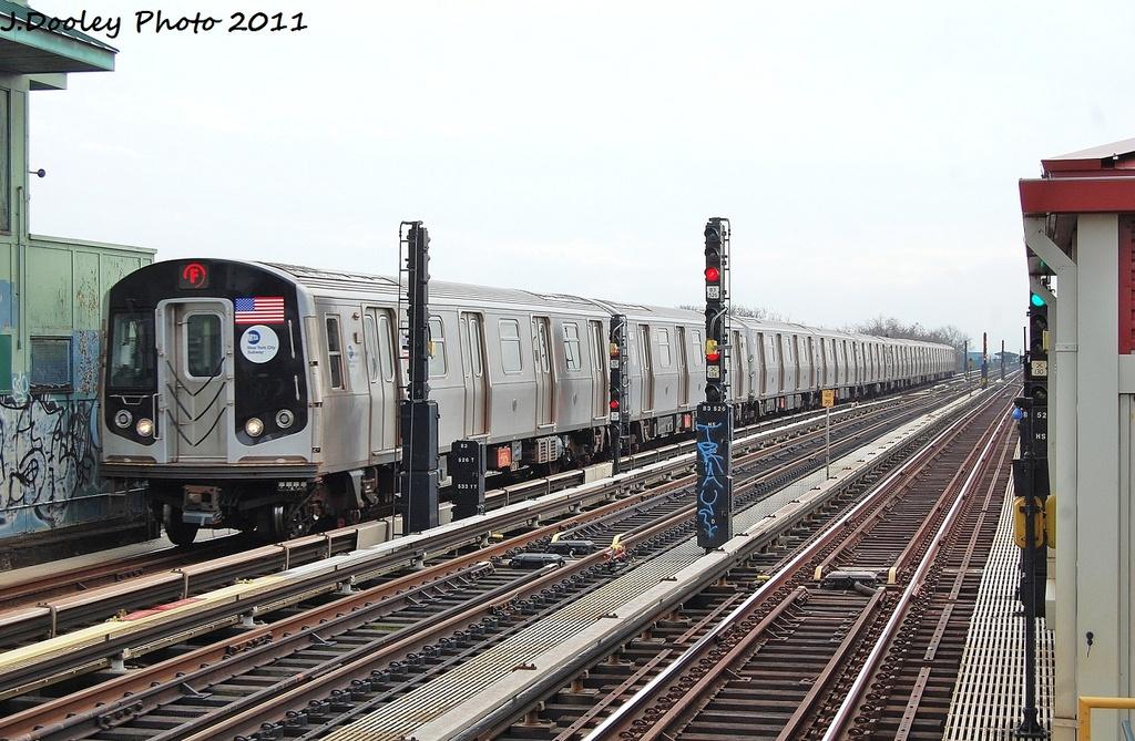 (348k, 1024x669)<br><b>Country:</b> United States<br><b>City:</b> New York<br><b>System:</b> New York City Transit<br><b>Line:</b> BMT Culver Line<br><b>Location:</b> Ditmas Avenue <br><b>Route:</b> F<br><b>Car:</b> R-160B (Option 2) (Kawasaki, 2009)  9933 <br><b>Photo by:</b> John Dooley<br><b>Date:</b> 12/5/2011<br><b>Viewed (this week/total):</b> 3 / 828
