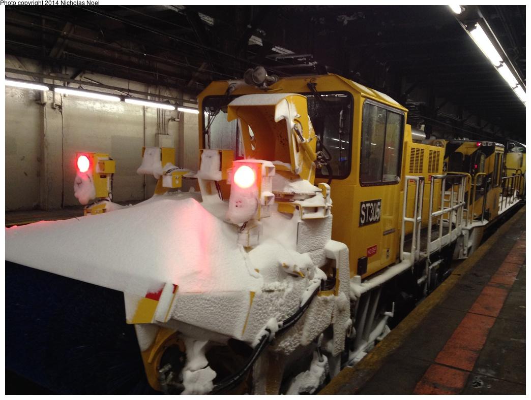 (260k, 1044x788)<br><b>Country:</b> United States<br><b>City:</b> New York<br><b>System:</b> New York City Transit<br><b>Line:</b> IRT Dyre Ave. Line<br><b>Location:</b> Pelham Parkway <br><b>Route:</b> Work Service<br><b>Car:</b> R-146 Snow Removal Car ST305 <br><b>Photo by:</b> Nicholas Noel<br><b>Date:</b> 2/13/2014<br><b>Viewed (this week/total):</b> 2 / 1418