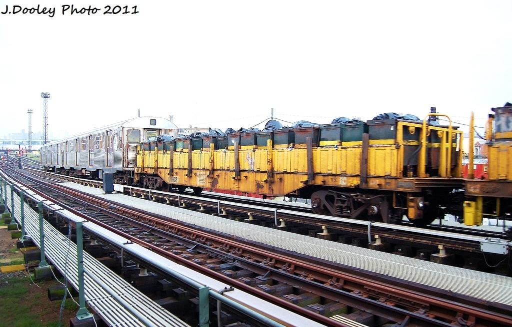 (323k, 1024x655)<br><b>Country:</b> United States<br><b>City:</b> New York<br><b>System:</b> New York City Transit<br><b>Line:</b> BMT Culver Line<br><b>Location:</b> Avenue X <br><b>Route:</b> Work Service<br><b>Car:</b> R-58 Refuse Collector Flat (Fuji, 1956)  RF02 <br><b>Photo by:</b> John Dooley<br><b>Date:</b> 8/26/2011<br><b>Viewed (this week/total):</b> 2 / 470
