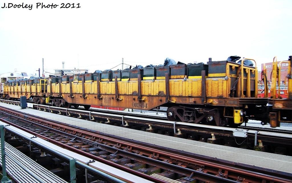 (329k, 1024x642)<br><b>Country:</b> United States<br><b>City:</b> New York<br><b>System:</b> New York City Transit<br><b>Line:</b> BMT Culver Line<br><b>Location:</b> Avenue X <br><b>Route:</b> Work Service<br><b>Car:</b> R-58 Refuse Collector Flat (Fuji, 1956)  RF04 <br><b>Photo by:</b> John Dooley<br><b>Date:</b> 8/26/2011<br><b>Viewed (this week/total):</b> 0 / 609