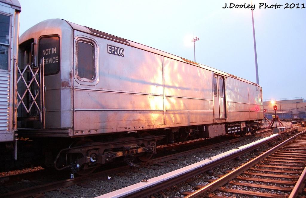 (309k, 1024x665)<br><b>Country:</b> United States<br><b>City:</b> New York<br><b>System:</b> New York City Transit<br><b>Location:</b> 36th Street Yard<br><b>Car:</b> R-127/R-134 (Kawasaki, 1991-1996) EP009 <br><b>Photo by:</b> John Dooley<br><b>Date:</b> 12/29/2011<br><b>Viewed (this week/total):</b> 1 / 839