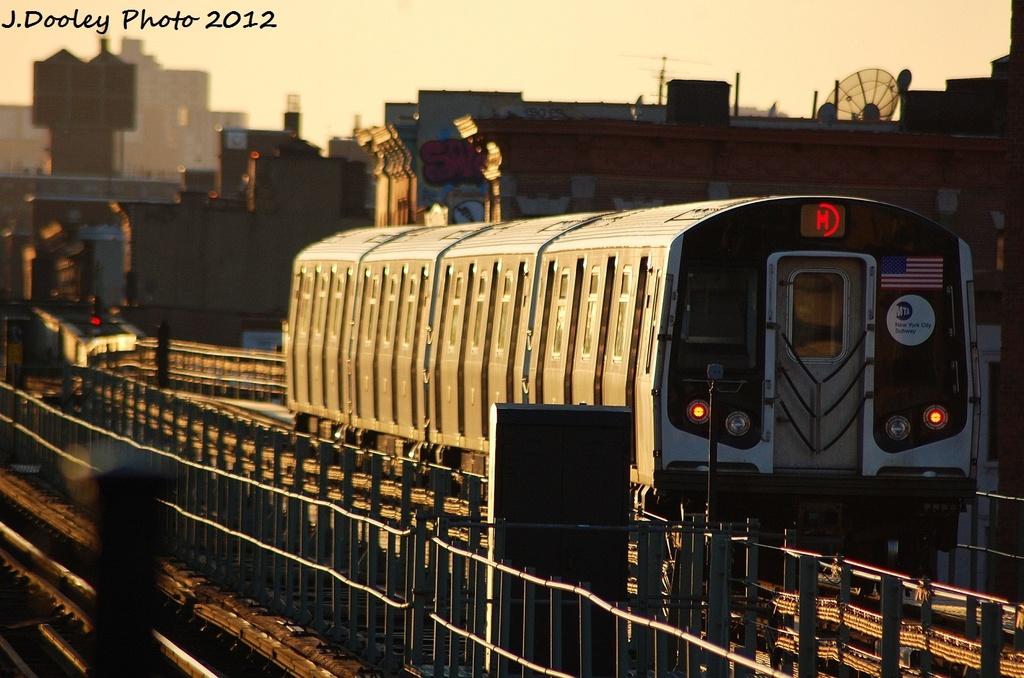 (312k, 1024x678)<br><b>Country:</b> United States<br><b>City:</b> New York<br><b>System:</b> New York City Transit<br><b>Line:</b> BMT Myrtle Avenue Line<br><b>Location:</b> Central Avenue <br><b>Route:</b> M<br><b>Car:</b> R-160A (Option 2) (Alstom, 2009, 4-car sets)  9954 <br><b>Photo by:</b> John Dooley<br><b>Date:</b> 1/28/2012<br><b>Viewed (this week/total):</b> 2 / 1050