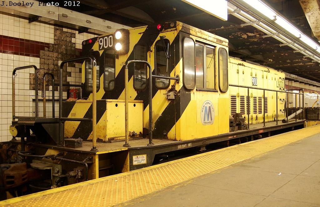 (369k, 1024x663)<br><b>Country:</b> United States<br><b>City:</b> New York<br><b>System:</b> New York City Transit<br><b>Line:</b> IND Crosstown Line<br><b>Location:</b> Church Avenue <br><b>Route:</b> Work Service<br><b>Car:</b> R-77 Locomotive  900 <br><b>Photo by:</b> John Dooley<br><b>Date:</b> 3/27/2012<br><b>Viewed (this week/total):</b> 0 / 582