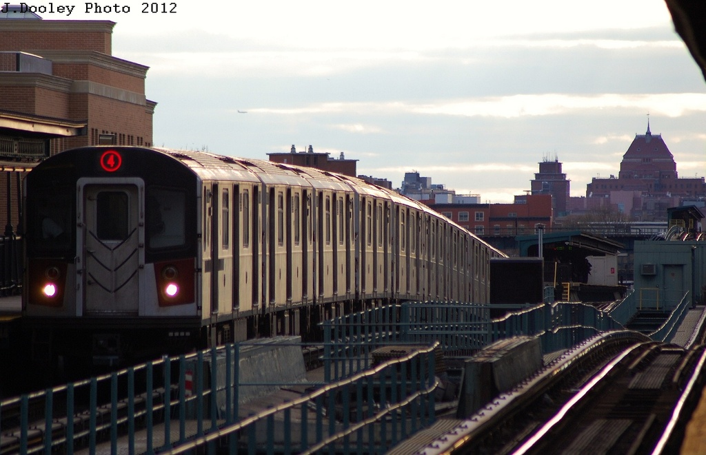 (259k, 1024x661)<br><b>Country:</b> United States<br><b>City:</b> New York<br><b>System:</b> New York City Transit<br><b>Line:</b> IRT Brooklyn Line<br><b>Location:</b> Van Siclen Avenue <br><b>Route:</b> 4<br><b>Car:</b> R-142A (Supplemental Order, Kawasaki, 2003-2004)  7801 <br><b>Photo by:</b> John Dooley<br><b>Date:</b> 3/29/2012<br><b>Viewed (this week/total):</b> 2 / 1131