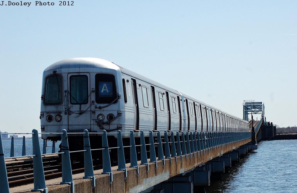 (273k, 1024x665)<br><b>Country:</b> United States<br><b>City:</b> New York<br><b>System:</b> New York City Transit<br><b>Line:</b> IND Rockaway<br><b>Location:</b> North Channel Bridge <br><b>Route:</b> A<br><b>Car:</b> R-46 (Pullman-Standard, 1974-75) 6114 <br><b>Photo by:</b> John Dooley<br><b>Date:</b> 3/27/2012<br><b>Viewed (this week/total):</b> 0 / 682