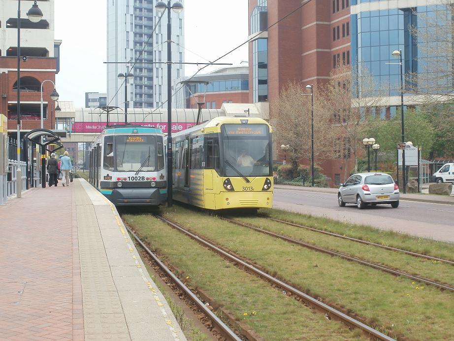 (140k, 922x692)<br><b>Country:</b> United Kingdom<br><b>City:</b> Manchester<br><b>System:</b> Metrolink <br><b>Line:</b> Eccles line<br><b>Location:</b> Harbour City <br><b>Car:</b>  1002/3013 <br><b>Photo by:</b> Rob Morel<br><b>Date:</b> 4/15/2011<br><b>Viewed (this week/total):</b> 2 / 653