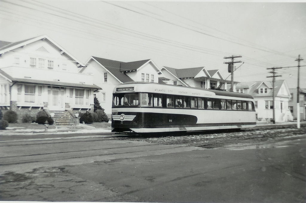 (198k, 1024x682)<br><b>Country:</b> United States<br><b>City:</b> Atlantic City, NJ<br><b>System:</b> Atlantic City Transit<br><b>Car:</b> Atlantic City Brilliner (J.G. Brill, 1940)  <br><b>Collection of:</b> Jeremy Whiteman<br><b>Notes:</b> Looks like lower Ventnor City, down dowards Margate. Those houses are still there and the exact cross street could be pinpointed. The car is headed Westbound towards the Douglas Avenue (cutback) loop in Margate. From the car number and the 7 cent fare, it's circa 1946 or 1947. The cars were renumbered from the 6900 series to the 200 series in early 1946.<br><b>Viewed (this week/total):</b> 5 / 1828