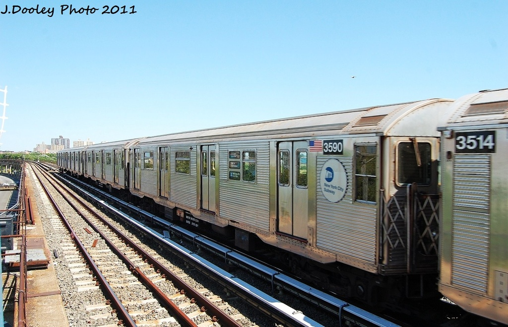 (325k, 1024x659)<br><b>Country:</b> United States<br><b>City:</b> New York<br><b>System:</b> New York City Transit<br><b>Line:</b> IND Rockaway<br><b>Location:</b> Beach 44th Street/Frank Avenue <br><b>Route:</b> A<br><b>Car:</b> R-32 (Budd, 1964)  3590 <br><b>Photo by:</b> John Dooley<br><b>Date:</b> 8/11/2011<br><b>Viewed (this week/total):</b> 1 / 722