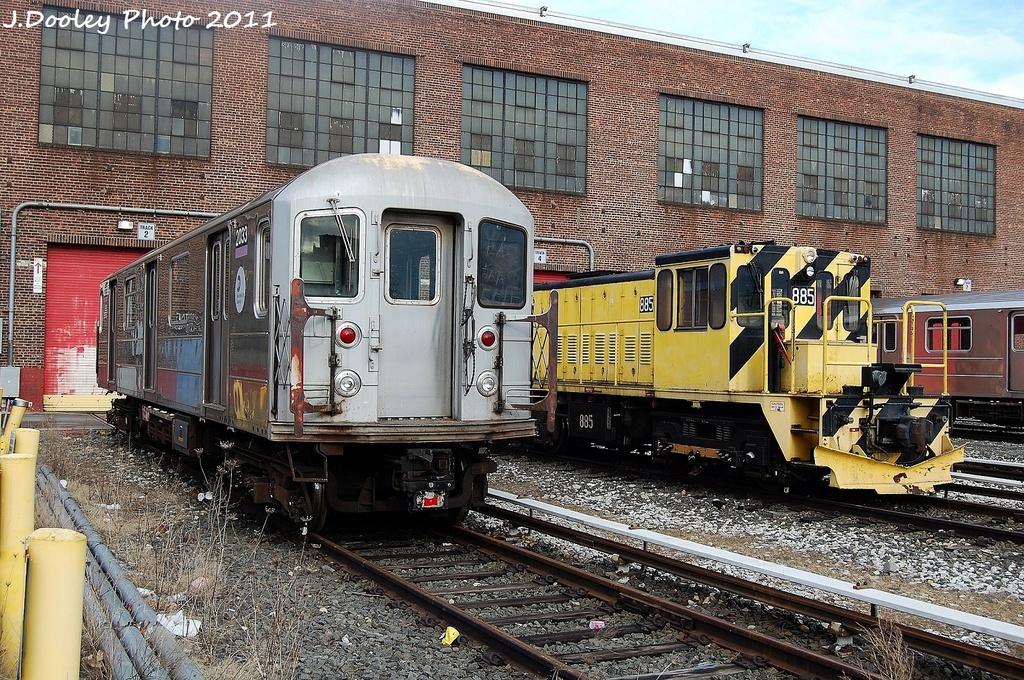(483k, 1024x680)<br><b>Country:</b> United States<br><b>City:</b> New York<br><b>System:</b> New York City Transit<br><b>Location:</b> 207th Street Yard<br><b>Car:</b> R-62A (Bombardier, 1984-1987)  2033 <br><b>Photo by:</b> John Dooley<br><b>Date:</b> 11/29/2011<br><b>Notes:</b> With loco 885<br><b>Viewed (this week/total):</b> 1 / 601