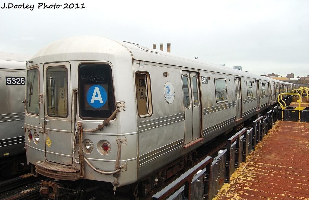(310k, 1024x663)<br><b>Country:</b> United States<br><b>City:</b> New York<br><b>System:</b> New York City Transit<br><b>Location:</b> 207th Street Yard<br><b>Car:</b> R-44 (St. Louis, 1971-73) 5210 <br><b>Photo by:</b> John Dooley<br><b>Date:</b> 11/29/2011<br><b>Viewed (this week/total):</b> 3 / 602