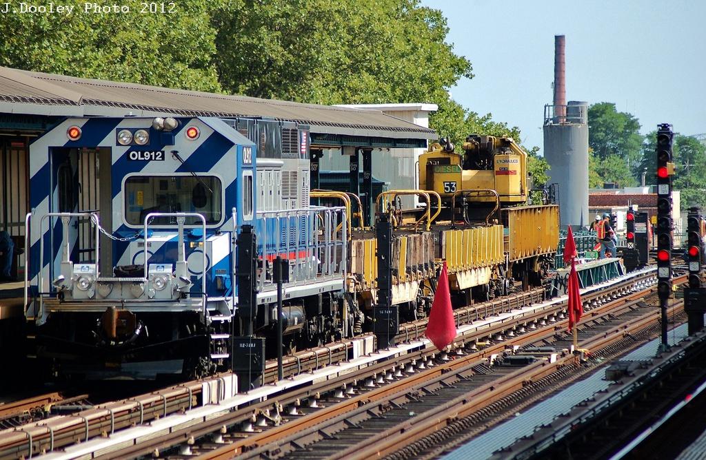 (449k, 1024x668)<br><b>Country:</b> United States<br><b>City:</b> New York<br><b>System:</b> New York City Transit<br><b>Line:</b> BMT West End Line<br><b>Location:</b> Bay 50th Street <br><b>Route:</b> Work Service<br><b>Car:</b> R-156 Diesel-Electric Locomotive (MPI, 2012-2013) 912 <br><b>Photo by:</b> John Dooley<br><b>Date:</b> 7/29/2012<br><b>Viewed (this week/total):</b> 0 / 1439