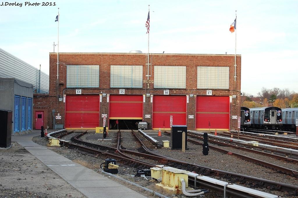 (358k, 1024x680)<br><b>Country:</b> United States<br><b>City:</b> New York<br><b>System:</b> New York City Transit<br><b>Location:</b> Jamaica Yard/Shops<br><b>Photo by:</b> John Dooley<br><b>Date:</b> 11/19/2011<br><b>Notes:</b> Shop building.<br><b>Viewed (this week/total):</b> 0 / 605