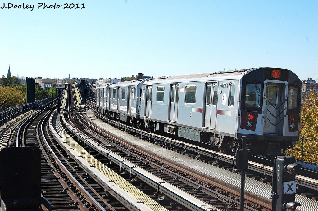 (366k, 1024x680)<br><b>Country:</b> United States<br><b>City:</b> New York<br><b>System:</b> New York City Transit<br><b>Line:</b> IRT Pelham Line<br><b>Location:</b> Middletown Road <br><b>Route:</b> 6<br><b>Car:</b> R-142A (Primary Order, Kawasaki, 1999-2002)  7606 <br><b>Photo by:</b> John Dooley<br><b>Date:</b> 11/5/2011<br><b>Viewed (this week/total):</b> 1 / 683