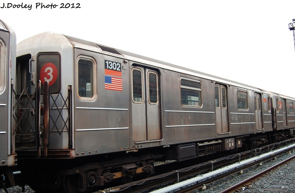 (252k, 1024x668)<br><b>Country:</b> United States<br><b>City:</b> New York<br><b>System:</b> New York City Transit<br><b>Location:</b> Livonia Yard<br><b>Car:</b> R-62 (Kawasaki, 1983-1985)  1302 <br><b>Photo by:</b> John Dooley<br><b>Date:</b> 1/26/2012<br><b>Viewed (this week/total):</b> 3 / 1306