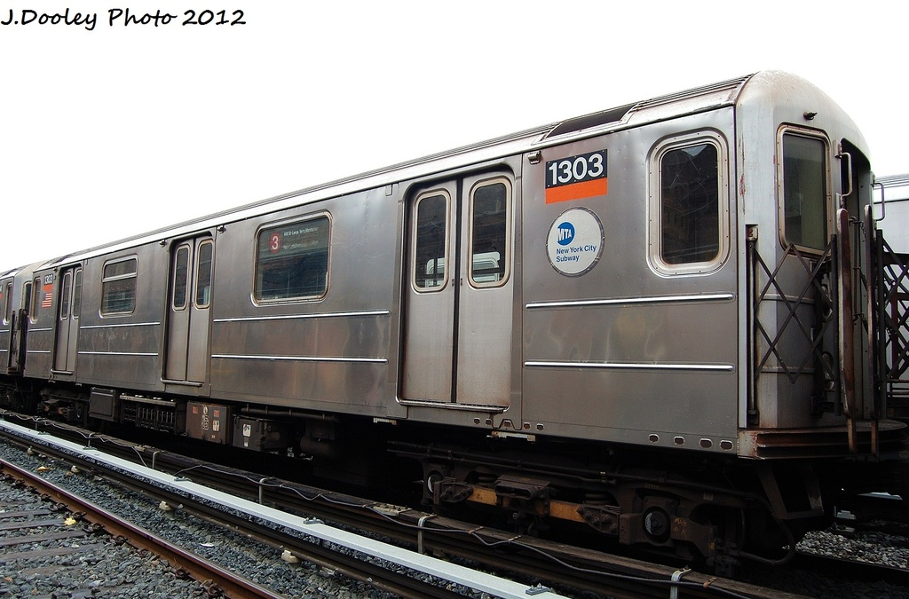 (283k, 1024x675)<br><b>Country:</b> United States<br><b>City:</b> New York<br><b>System:</b> New York City Transit<br><b>Location:</b> Livonia Yard<br><b>Car:</b> R-62 (Kawasaki, 1983-1985)  1303 <br><b>Photo by:</b> John Dooley<br><b>Date:</b> 1/26/2012<br><b>Viewed (this week/total):</b> 6 / 1165