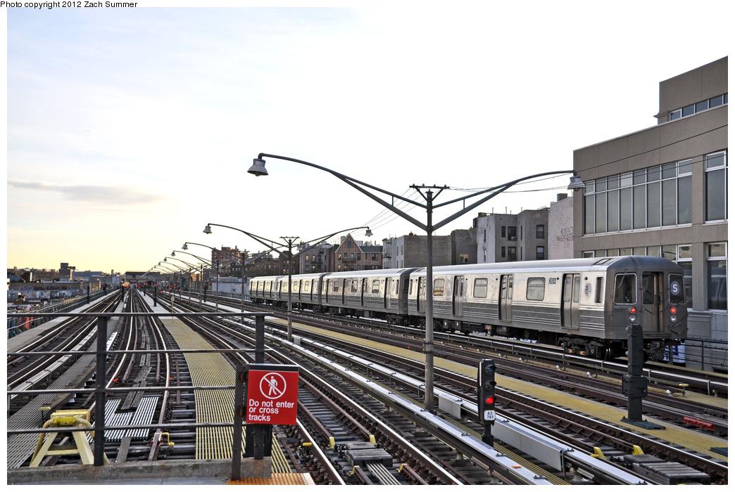 (341k, 1044x700)<br><b>Country:</b> United States<br><b>City:</b> New York<br><b>System:</b> New York City Transit<br><b>Line:</b> BMT Brighton Line<br><b>Location:</b> Ocean Parkway <br><b>Route:</b> FS yard move<br><b>Car:</b> R-68 (Westinghouse-Amrail, 1986-1988)  2924 <br><b>Photo by:</b> Zach Summer<br><b>Date:</b> 1/8/2012<br><b>Notes:</b> 4-Car Franklin Av Shuttle running light from Coney Island Yard to Prospect Park<br><b>Viewed (this week/total):</b> 0 / 1249