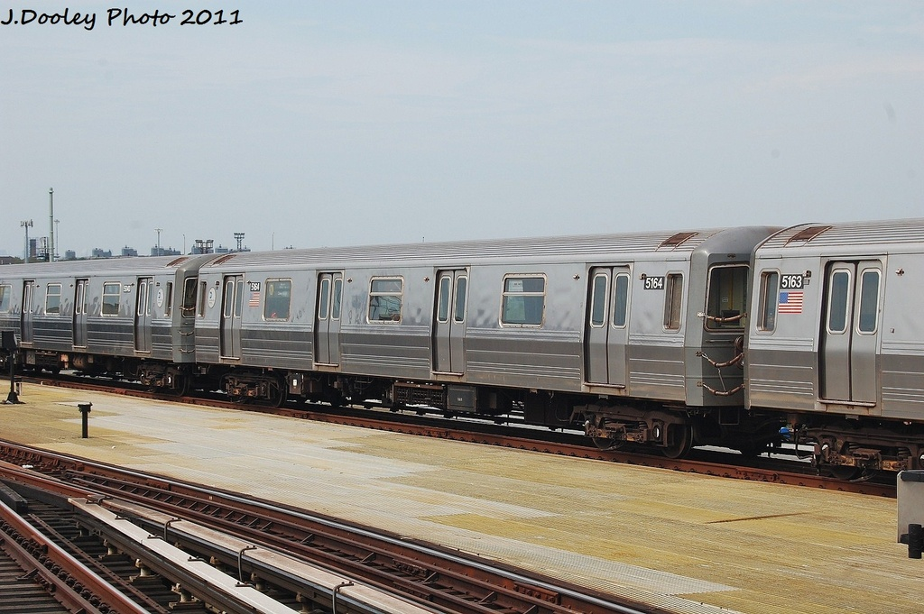 (310k, 1024x681)<br><b>Country:</b> United States<br><b>City:</b> New York<br><b>System:</b> New York City Transit<br><b>Location:</b> Coney Island/Stillwell Avenue<br><b>Route:</b> N<br><b>Car:</b> R-68A (Kawasaki, 1988-1989)  5164 <br><b>Photo by:</b> John Dooley<br><b>Date:</b> 7/23/2011<br><b>Viewed (this week/total):</b> 0 / 739