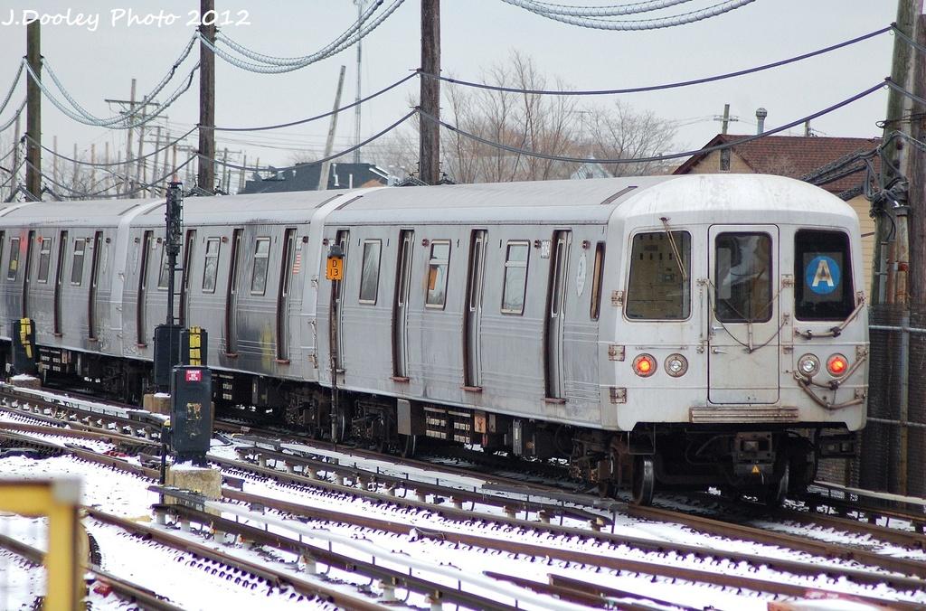 (381k, 1024x676)<br><b>Country:</b> United States<br><b>City:</b> New York<br><b>System:</b> New York City Transit<br><b>Line:</b> IND Rockaway<br><b>Location:</b> Howard Beach <br><b>Route:</b> A<br><b>Car:</b> R-46 (Pullman-Standard, 1974-75) 6064 <br><b>Photo by:</b> John Dooley<br><b>Date:</b> 1/22/2012<br><b>Viewed (this week/total):</b> 0 / 955