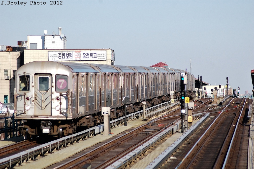 (340k, 1024x680)<br><b>Country:</b> United States<br><b>City:</b> New York<br><b>System:</b> New York City Transit<br><b>Line:</b> IRT Flushing Line<br><b>Location:</b> 69th Street/Fisk Avenue <br><b>Route:</b> 7<br><b>Car:</b> R-62A (Bombardier, 1984-1987)   <br><b>Photo by:</b> John Dooley<br><b>Date:</b> 3/6/2012<br><b>Viewed (this week/total):</b> 1 / 975