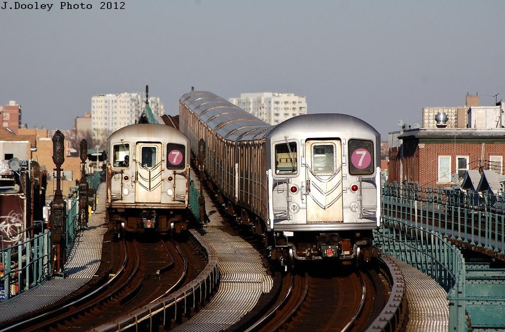 (360k, 1024x674)<br><b>Country:</b> United States<br><b>City:</b> New York<br><b>System:</b> New York City Transit<br><b>Line:</b> IRT Flushing Line<br><b>Location:</b> 103rd Street/Corona Plaza <br><b>Route:</b> 7<br><b>Car:</b> R-62A (Bombardier, 1984-1987)  1900 <br><b>Photo by:</b> John Dooley<br><b>Date:</b> 3/6/2012<br><b>Viewed (this week/total):</b> 1 / 1210