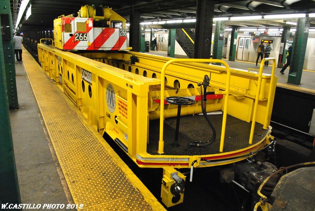 (358k, 1024x687)<br><b>Country:</b> United States<br><b>City:</b> New York<br><b>System:</b> New York City Transit<br><b>Line:</b> IND 6th Avenue Line<br><b>Location:</b> West 4th Street/Washington Square <br><b>Route:</b> Work Service<br><b>Car:</b> R-113 Crane Car  266 <br><b>Photo by:</b> Wilfredo Castillo<br><b>Date:</b> 4/25/2012<br><b>Viewed (this week/total):</b> 4 / 986