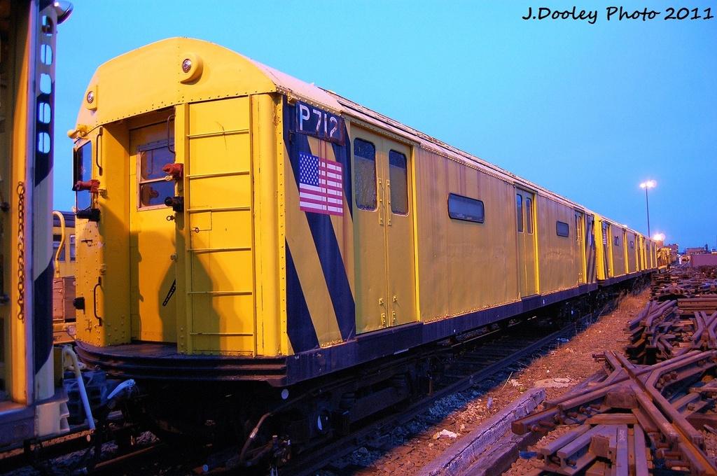 (330k, 1024x680)<br><b>Country:</b> United States<br><b>City:</b> New York<br><b>System:</b> New York City Transit<br><b>Location:</b> 36th Street Yard<br><b>Car:</b> R-71 Pump/Reach Car (R-17/R-21/R-22 Rebuilds) P7121 <br><b>Photo by:</b> John Dooley<br><b>Date:</b> 12/29/2011<br><b>Viewed (this week/total):</b> 5 / 1264