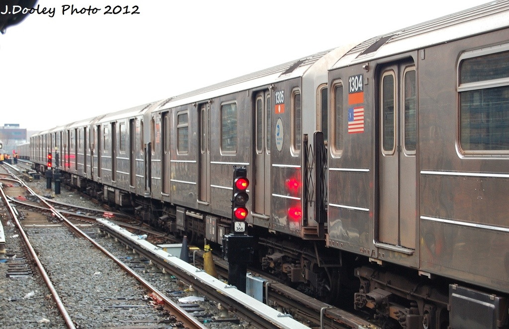 (293k, 1024x663)<br><b>Country:</b> United States<br><b>City:</b> New York<br><b>System:</b> New York City Transit<br><b>Location:</b> Livonia Yard<br><b>Car:</b> R-62 (Kawasaki, 1983-1985)  1305 <br><b>Photo by:</b> John Dooley<br><b>Date:</b> 1/26/2012<br><b>Viewed (this week/total):</b> 3 / 1086