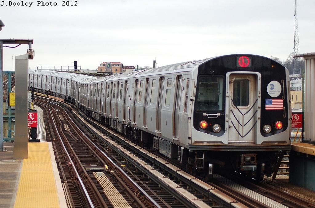 (316k, 1024x677)<br><b>Country:</b> United States<br><b>City:</b> New York<br><b>System:</b> New York City Transit<br><b>Line:</b> BMT Canarsie Line<br><b>Location:</b> Sutter Avenue <br><b>Route:</b> L<br><b>Car:</b> R-143 (Kawasaki, 2001-2002) 8157 <br><b>Photo by:</b> John Dooley<br><b>Date:</b> 3/15/2012<br><b>Viewed (this week/total):</b> 1 / 806