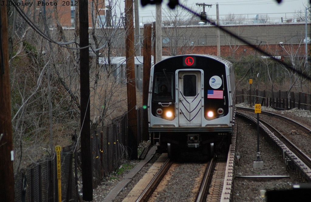(342k, 1024x666)<br><b>Country:</b> United States<br><b>City:</b> New York<br><b>System:</b> New York City Transit<br><b>Line:</b> BMT Canarsie Line<br><b>Location:</b> East 105th Street <br><b>Route:</b> L<br><b>Car:</b> R-143 (Kawasaki, 2001-2002) 8209 <br><b>Photo by:</b> John Dooley<br><b>Date:</b> 3/15/2012<br><b>Viewed (this week/total):</b> 0 / 849