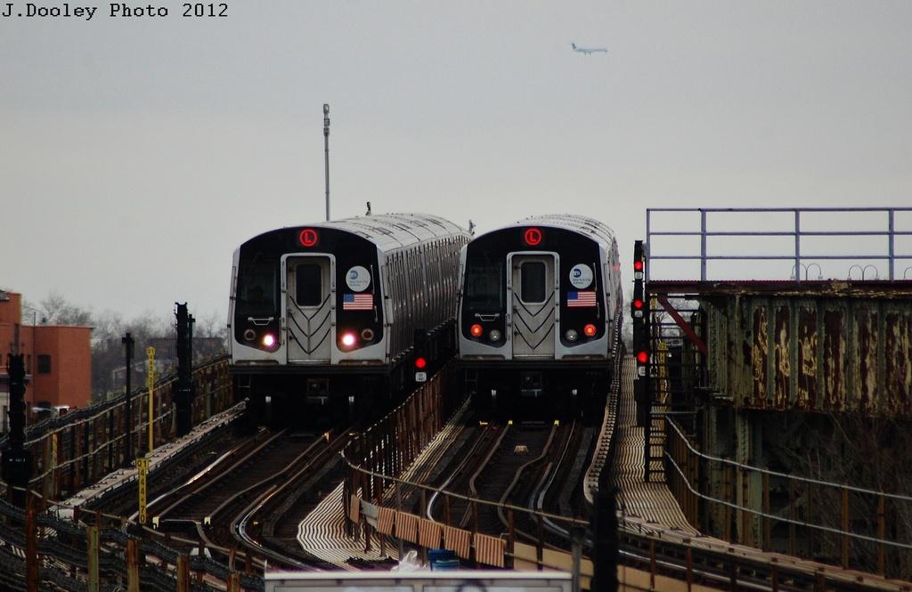 (272k, 1024x665)<br><b>Country:</b> United States<br><b>City:</b> New York<br><b>System:</b> New York City Transit<br><b>Line:</b> BMT Canarsie Line<br><b>Location:</b> Sutter Avenue <br><b>Route:</b> L<br><b>Car:</b> R-143 (Kawasaki, 2001-2002) 8221 <br><b>Photo by:</b> John Dooley<br><b>Date:</b> 3/15/2012<br><b>Viewed (this week/total):</b> 0 / 794