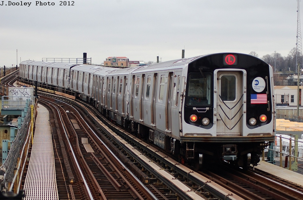 (348k, 1024x677)<br><b>Country:</b> United States<br><b>City:</b> New York<br><b>System:</b> New York City Transit<br><b>Line:</b> BMT Canarsie Line<br><b>Location:</b> Sutter Avenue <br><b>Route:</b> L<br><b>Car:</b> R-143 (Kawasaki, 2001-2002) 8249 <br><b>Photo by:</b> John Dooley<br><b>Date:</b> 3/15/2012<br><b>Viewed (this week/total):</b> 0 / 726