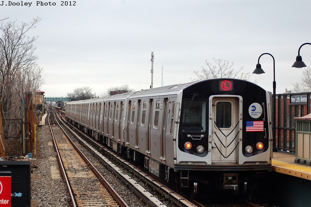 (332k, 1024x680)<br><b>Country:</b> United States<br><b>City:</b> New York<br><b>System:</b> New York City Transit<br><b>Line:</b> BMT Canarsie Line<br><b>Location:</b> New Lots Avenue <br><b>Route:</b> L<br><b>Car:</b> R-143 (Kawasaki, 2001-2002) 8253 <br><b>Photo by:</b> John Dooley<br><b>Date:</b> 3/15/2012<br><b>Viewed (this week/total):</b> 1 / 902