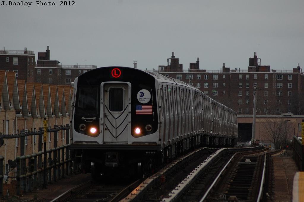 (223k, 1024x680)<br><b>Country:</b> United States<br><b>City:</b> New York<br><b>System:</b> New York City Transit<br><b>Line:</b> BMT Canarsie Line<br><b>Location:</b> New Lots Avenue <br><b>Route:</b> L<br><b>Car:</b> R-143 (Kawasaki, 2001-2002) 8308 <br><b>Photo by:</b> John Dooley<br><b>Date:</b> 3/15/2012<br><b>Viewed (this week/total):</b> 8 / 998