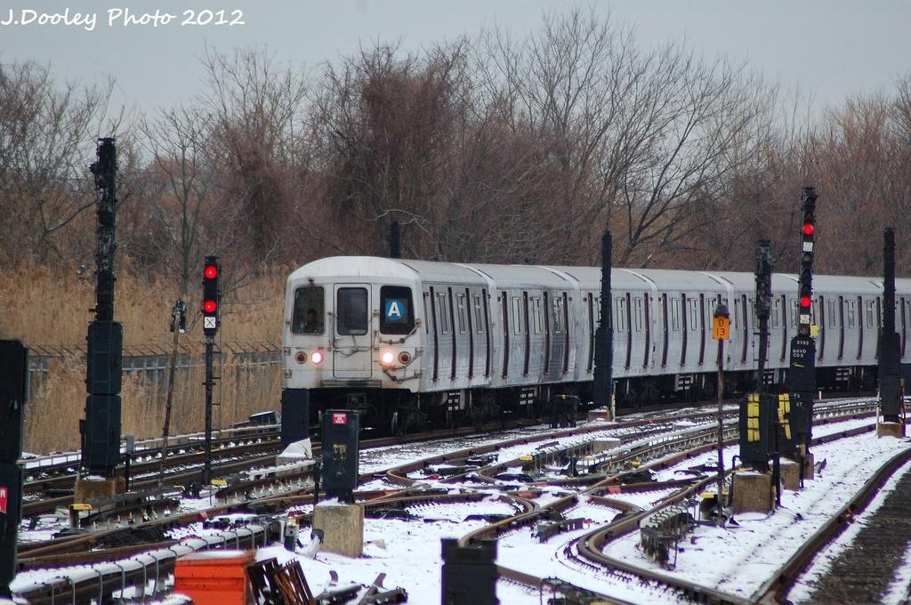 (406k, 1024x680)<br><b>Country:</b> United States<br><b>City:</b> New York<br><b>System:</b> New York City Transit<br><b>Line:</b> IND Rockaway<br><b>Location:</b> Howard Beach <br><b>Route:</b> A<br><b>Car:</b> R-46 (Pullman-Standard, 1974-75) 6000 <br><b>Photo by:</b> John Dooley<br><b>Date:</b> 1/22/2012<br><b>Viewed (this week/total):</b> 0 / 897