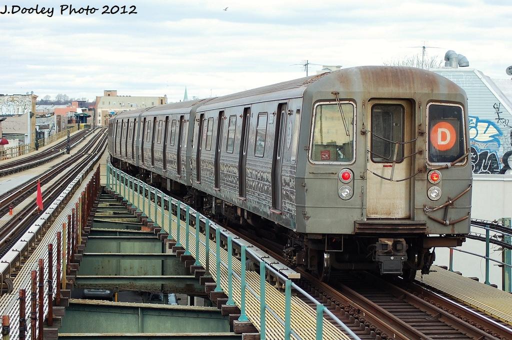(390k, 1024x680)<br><b>Country:</b> United States<br><b>City:</b> New York<br><b>System:</b> New York City Transit<br><b>Line:</b> BMT West End Line<br><b>Location:</b> 62nd Street <br><b>Route:</b> D<br><b>Car:</b> R-68 (Westinghouse-Amrail, 1986-1988)  2616 <br><b>Photo by:</b> John Dooley<br><b>Date:</b> 1/8/2012<br><b>Viewed (this week/total):</b> 3 / 681