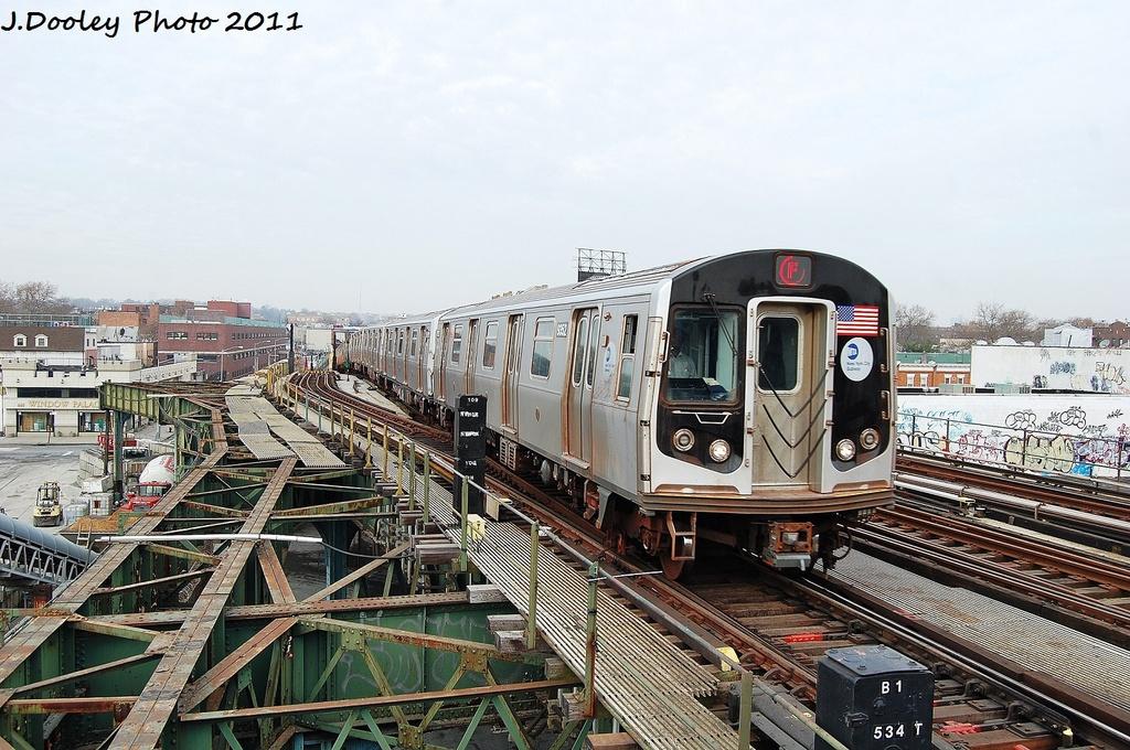 (369k, 1024x680)<br><b>Country:</b> United States<br><b>City:</b> New York<br><b>System:</b> New York City Transit<br><b>Line:</b> BMT Culver Line<br><b>Location:</b> Ditmas Avenue <br><b>Route:</b> F<br><b>Car:</b> R-160A (Option 1) (Alstom, 2008-2009, 5 car sets)  9352 <br><b>Photo by:</b> John Dooley<br><b>Date:</b> 12/5/2011<br><b>Viewed (this week/total):</b> 1 / 1108