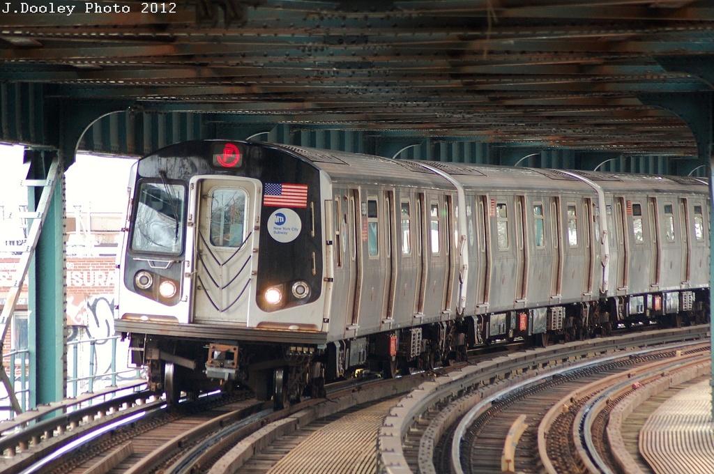 (357k, 1024x680)<br><b>Country:</b> United States<br><b>City:</b> New York<br><b>System:</b> New York City Transit<br><b>Line:</b> BMT Culver Line<br><b>Location:</b> West 8th Street <br><b>Route:</b> F<br><b>Car:</b> R-160A (Option 1) (Alstom, 2008-2009, 5 car sets)  9393 <br><b>Photo by:</b> John Dooley<br><b>Date:</b> 3/21/2012<br><b>Viewed (this week/total):</b> 0 / 1174