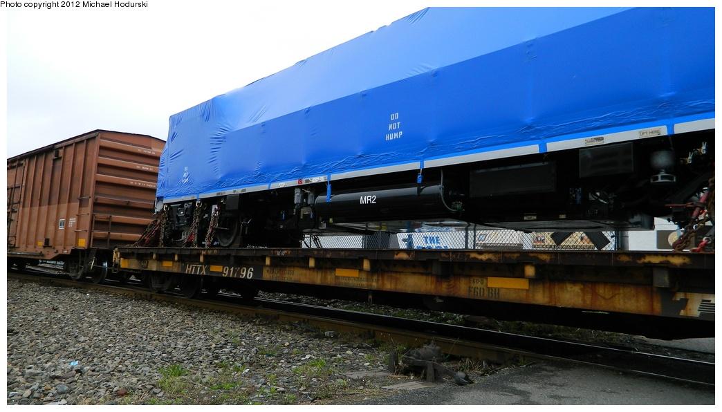 (240k, 1044x596)<br><b>Country:</b> United States<br><b>City:</b> New York<br><b>System:</b> New York City Transit<br><b>Line:</b> South Brooklyn Railway<br><b>Location:</b> SBK Yard (2nd Ave at 38th St.) (SBK)<br><b>Car:</b> R-156 Diesel-Electric Locomotive (MPI, 2012-2013) 912 <br><b>Photo by:</b> Michael Hodurski<br><b>Date:</b> 4/30/2012<br><b>Notes:</b> Delivery of first R-156 locomotive, 0L912.<br><b>Viewed (this week/total):</b> 2 / 999