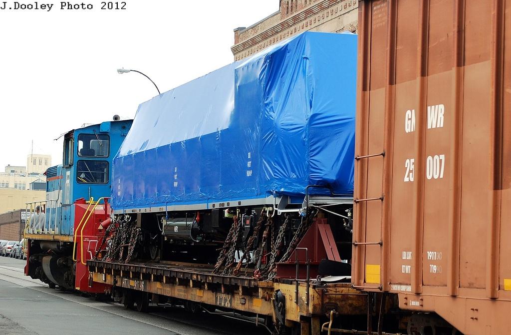 (307k, 1024x671)<br><b>Country:</b> United States<br><b>City:</b> New York<br><b>System:</b> New York City Transit<br><b>Line:</b> South Brooklyn Railway<br><b>Location:</b> SBK Yard (2nd Ave at 38th St.) (SBK)<br><b>Car:</b> R-156 Diesel-Electric Locomotive (MPI, 2012-2013) 912 <br><b>Photo by:</b> John Dooley<br><b>Date:</b> 5/1/2012<br><b>Notes:</b> En route from Bush Terminal to Linden Yd<br><b>Viewed (this week/total):</b> 3 / 1975