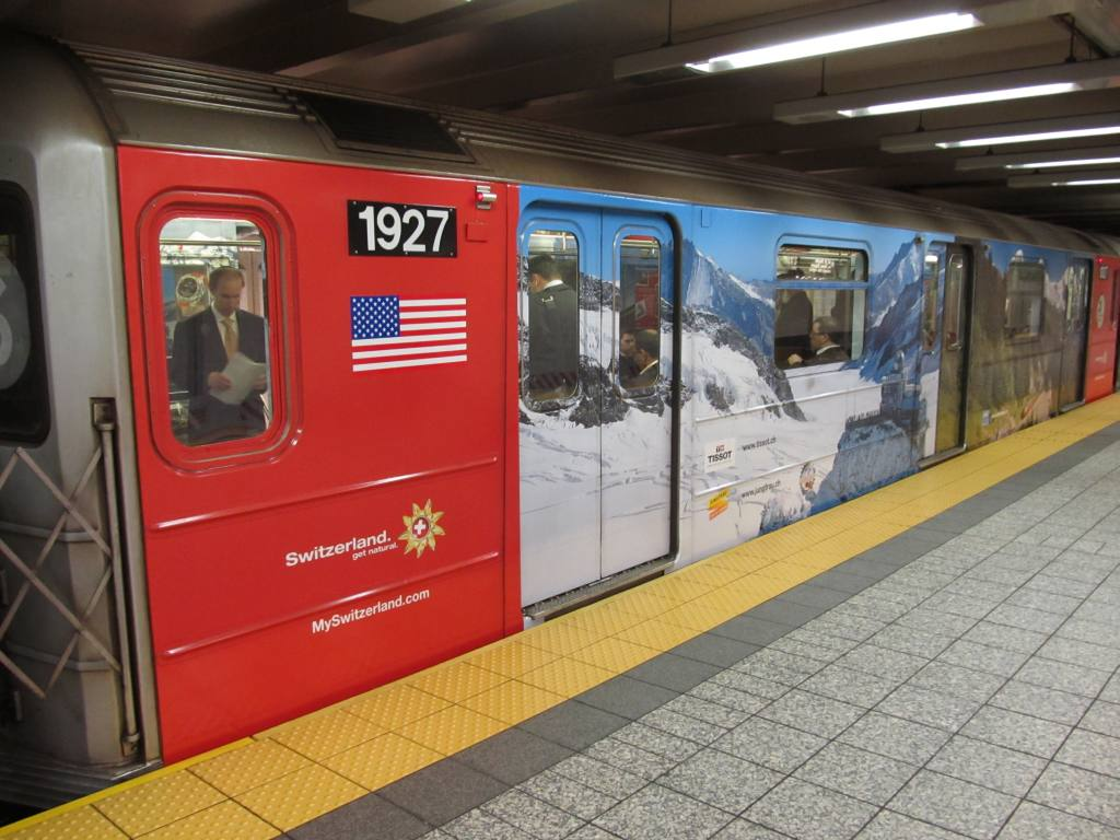 (114k, 1024x768)<br><b>Country:</b> United States<br><b>City:</b> New York<br><b>System:</b> New York City Transit<br><b>Line:</b> IRT Times Square-Grand Central Shuttle<br><b>Location:</b> Grand Central <br><b>Route:</b> S<br><b>Car:</b> R-62A (Bombardier, 1984-1987)  1927 <br><b>Photo by:</b> Robbie Rosenfeld<br><b>Date:</b> 5/3/2012<br><b>Notes:</b> Switzerland tourism ad wrap<br><b>Viewed (this week/total):</b> 0 / 567