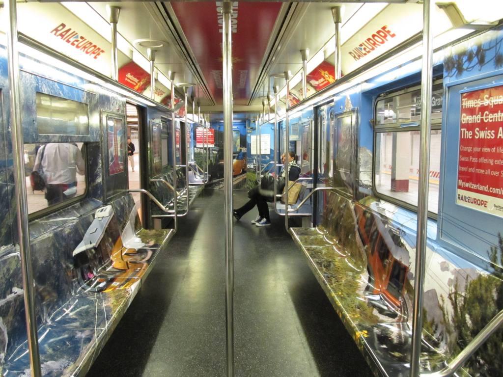 (154k, 1024x768)<br><b>Country:</b> United States<br><b>City:</b> New York<br><b>System:</b> New York City Transit<br><b>Route:</b> S<br><b>Car:</b> R-62A (Bombardier, 1984-1987)  Interior <br><b>Photo by:</b> Robbie Rosenfeld<br><b>Date:</b> 5/3/2012<br><b>Notes:</b> Switzerland tourism ad wrap<br><b>Viewed (this week/total):</b> 1 / 659
