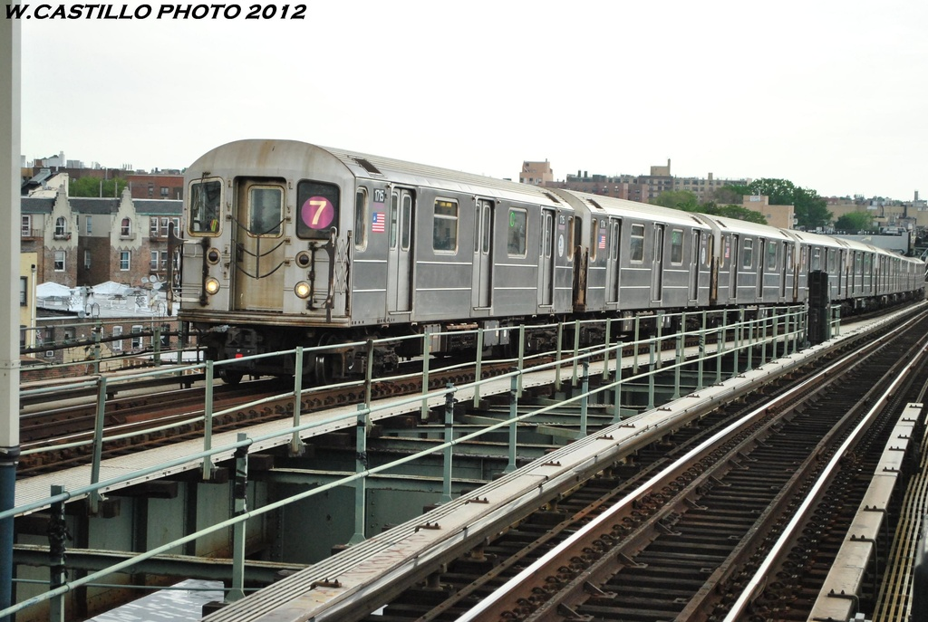 (311k, 1024x687)<br><b>Country:</b> United States<br><b>City:</b> New York<br><b>System:</b> New York City Transit<br><b>Line:</b> IRT Flushing Line<br><b>Location:</b> 61st Street/Woodside <br><b>Route:</b> 7<br><b>Car:</b> R-62A (Bombardier, 1984-1987)  1715 <br><b>Photo by:</b> Wilfredo Castillo<br><b>Date:</b> 5/14/2012<br><b>Viewed (this week/total):</b> 0 / 861