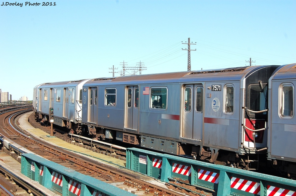 (322k, 1024x681)<br><b>Country:</b> United States<br><b>City:</b> New York<br><b>System:</b> New York City Transit<br><b>Line:</b> IRT Pelham Line<br><b>Location:</b> Whitlock Avenue <br><b>Route:</b> 6<br><b>Car:</b> R-142A (Primary Order, Kawasaki, 1999-2002)  7571 <br><b>Photo by:</b> John Dooley<br><b>Date:</b> 11/5/2011<br><b>Viewed (this week/total):</b> 0 / 812