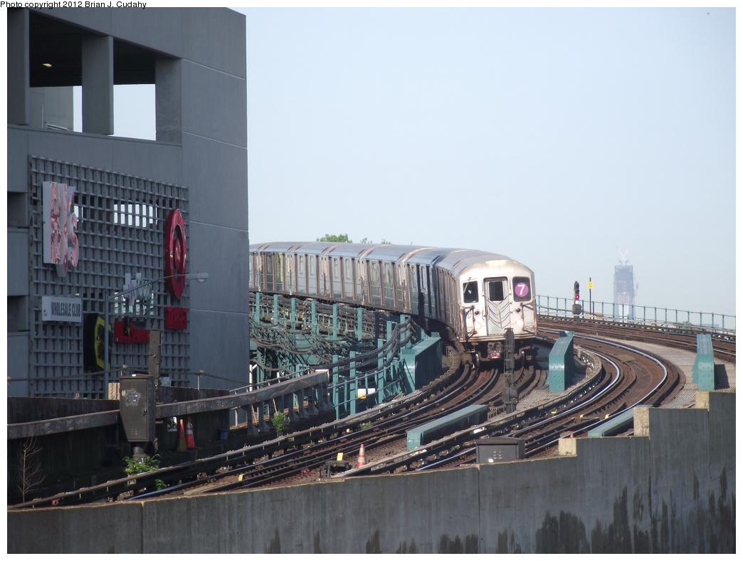 (305k, 1044x788)<br><b>Country:</b> United States<br><b>City:</b> New York<br><b>System:</b> New York City Transit<br><b>Line:</b> IRT Flushing Line<br><b>Location:</b> Main St. Tunnel Portal <br><b>Route:</b> 7<br><b>Car:</b> R-62A (Bombardier, 1984-1987)   <br><b>Photo by:</b> Brian J. Cudahy<br><b>Date:</b> 5/18/2011<br><b>Notes:</b> Note 1 WTC in background.<br><b>Viewed (this week/total):</b> 1 / 1193