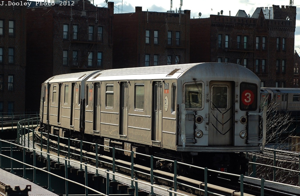 (373k, 1024x669)<br><b>Country:</b> United States<br><b>City:</b> New York<br><b>System:</b> New York City Transit<br><b>Line:</b> IRT Brooklyn Line<br><b>Location:</b> Saratoga Avenue <br><b>Route:</b> 3<br><b>Car:</b> R-62 (Kawasaki, 1983-1985)  1571 <br><b>Photo by:</b> John Dooley<br><b>Date:</b> 3/29/2012<br><b>Viewed (this week/total):</b> 1 / 880