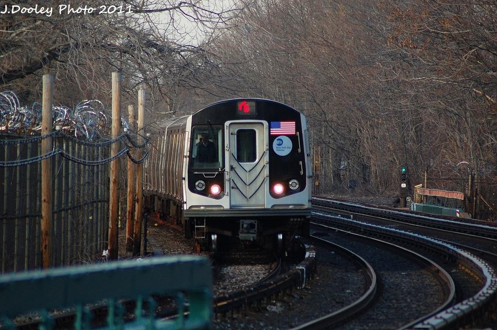 (406k, 1024x680)<br><b>Country:</b> United States<br><b>City:</b> New York<br><b>System:</b> New York City Transit<br><b>Line:</b> BMT Brighton Line<br><b>Location:</b> Sheepshead Bay <br><b>Route:</b> Q<br><b>Car:</b> R-160B (Option 1) (Kawasaki, 2008-2009)  9003 <br><b>Photo by:</b> John Dooley<br><b>Date:</b> 12/31/2011<br><b>Viewed (this week/total):</b> 0 / 948
