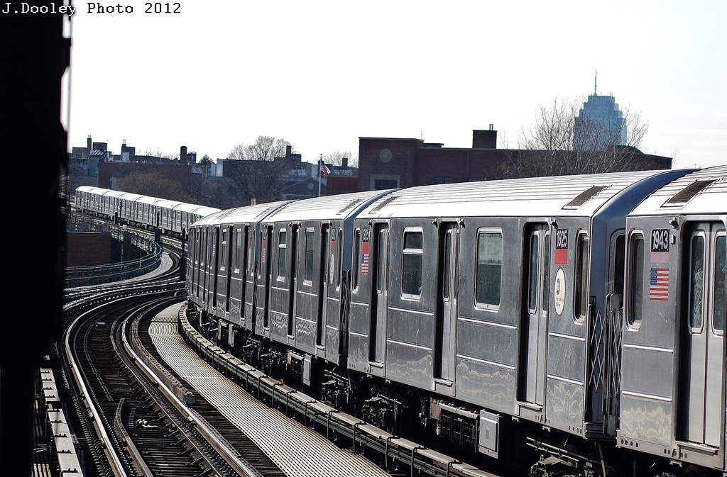 (325k, 1024x673)<br><b>Country:</b> United States<br><b>City:</b> New York<br><b>System:</b> New York City Transit<br><b>Line:</b> IRT Flushing Line<br><b>Location:</b> 61st Street/Woodside <br><b>Route:</b> 7<br><b>Car:</b> R-62A (Bombardier, 1984-1987)  1925 <br><b>Photo by:</b> John Dooley<br><b>Date:</b> 3/6/2012<br><b>Viewed (this week/total):</b> 0 / 1032
