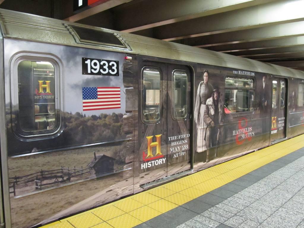 (126k, 1024x768)<br><b>Country:</b> United States<br><b>City:</b> New York<br><b>System:</b> New York City Transit<br><b>Line:</b> IRT Times Square-Grand Central Shuttle<br><b>Location:</b> Grand Central <br><b>Route:</b> S<br><b>Car:</b> R-62A (Bombardier, 1984-1987)  1933 <br><b>Photo by:</b> Robbie Rosenfeld<br><b>Date:</b> 5/22/2012<br><b>Notes:</b> Hatfields-McCoys wrap.<br><b>Viewed (this week/total):</b> 0 / 697